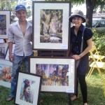 Worawuth and Mook with their watercolour paintings at the CityLife Garden Party Stall